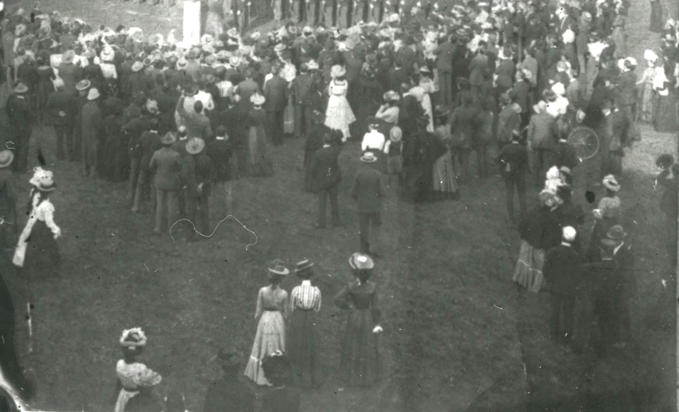 Victorian Era Photo of Event Around Flag on Campus
